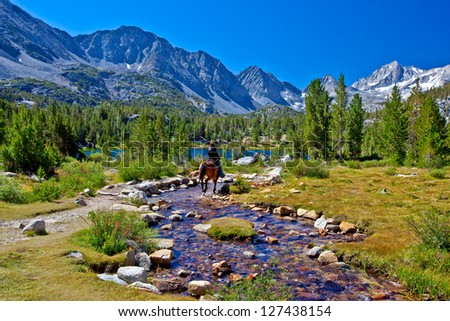 Horseback Rider in Mountains, Eastern Sierra, California - stock photo