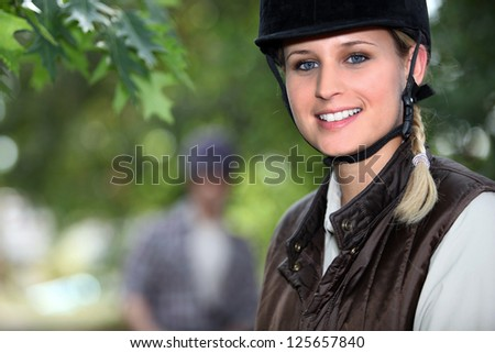 Horseback riding in the forest - stock photo
