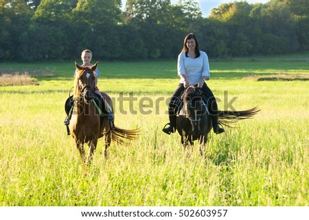 Horseback Riding Lessons - Woman Riding along a Boy on a Horse