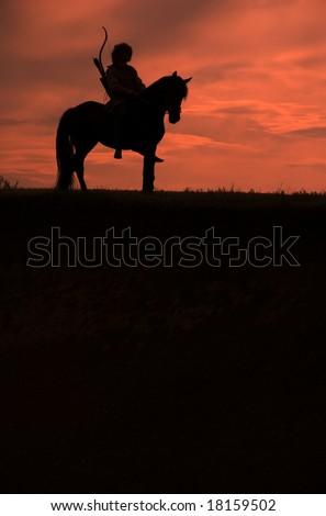 Horseman riding on the sunset vertical - stock photo