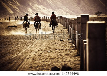 horsemen riding in Desert, going back to home, java indonesia - stock photo