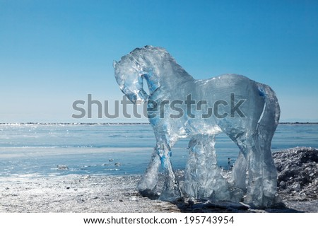 Horses, a sculptures  from ice on the frozen lake Baikal - stock photo