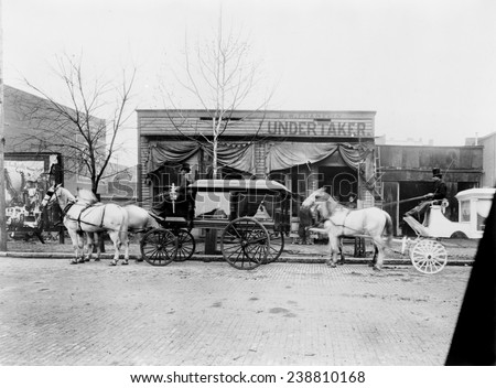 Horses and carriages in front of funeral home of C.W. Franklin, undertaker, Chattanooga, Tennessee, photograph, 1899 - stock photo
