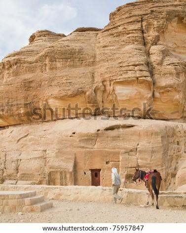 Horses are preferred transportation to ancient Petra, Jordan - stock photo