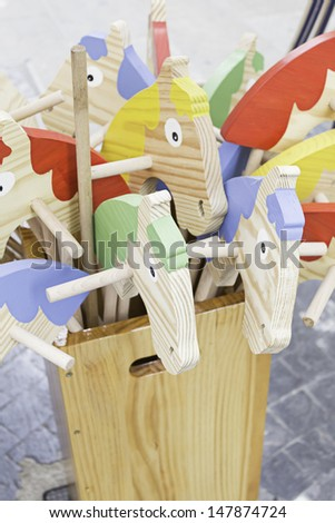 Horses stave handmade crafts in market - stock photo