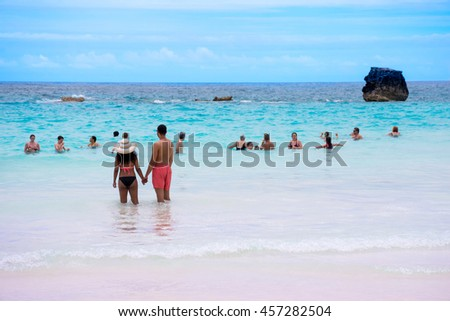 HORSESHOE BAY, BERMUDA - MAY 26 - A couple enjoys the pristine turquoise colored water of Horseshoe Bay on May 26 2016 in Bermuda. - stock photo