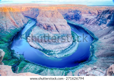 horseshoe bend at sunrise with clear sky and colorado river below - stock photo