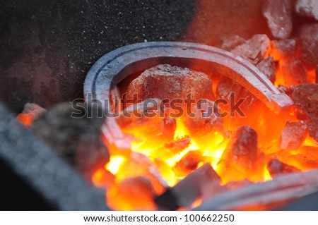 horseshoe in the forge - stock photo