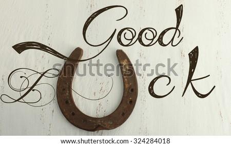 Horseshoe on a vintage background - Good luck - stock photo