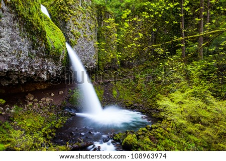 Horsetail shape waterfalls fall from the cliff - stock photo