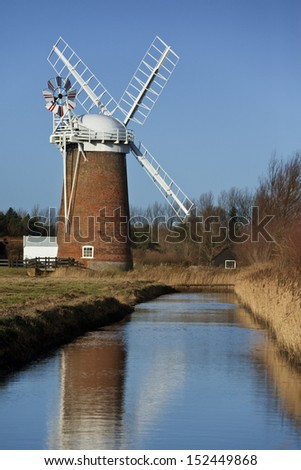 Horsey Windpump on the Horsey Marshes in Norfolk, England. The pump was used to drain the surrounding marsh land as this whole area is prone to flooding.
