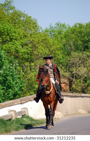 HORTOBAGY, HUNGARY - APRIL 25 : Hungarian horseman participates in the annual local festival St. George Day April 25, 2009 in Hortobagy, Hungary.