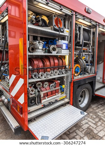 Hoses, Valves and other Inventory of a Fire Engine - stock photo