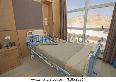 Hospital bed in a private hospital ward - stock photo