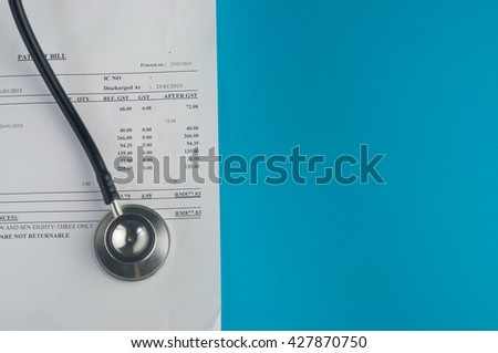Hospital Bills with stethoscope and glasses