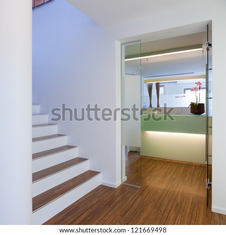 Hospital, Clinical interior or reception of a medical practice waiting room - stock photo
