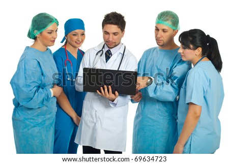 Hospital director man with laptop showing something to a surgeons team isolated on white background - stock photo