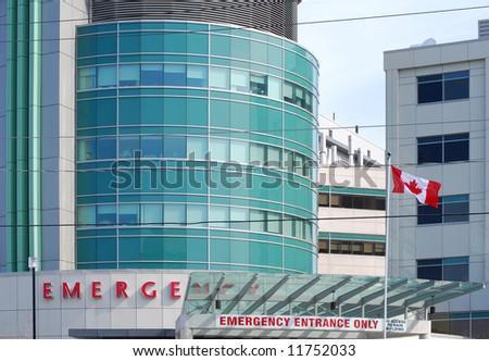 Hospital flying a Canadian flag - stock photo