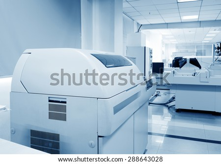 Hospital laboratories, automatic biochemical analyzer - stock photo