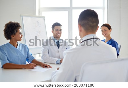 hospital, medical education, health care, people and medicine concept - group of happy doctors meeting at medical office - stock photo