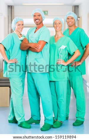 Hospital - medical surgery team is ready for the operation, the women and men wearing scrubs in a clinic - stock photo
