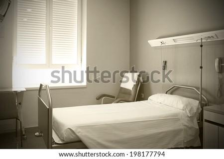 Hospital room interior in sepia tone. Horizontal format - stock photo