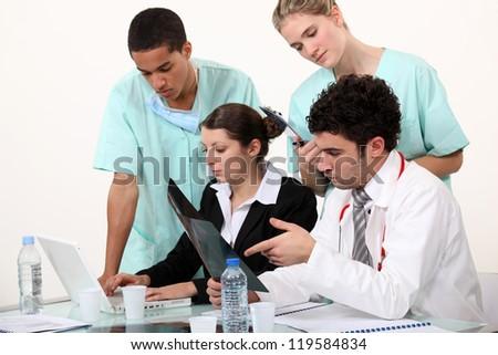 hospital staff analyzing a case - stock photo