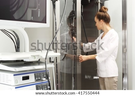 Hospital ward, gastroenterologist preparing the study. Doctor gastroenterologist with probe to perform gastroscopy and colonoscopy  - stock photo
