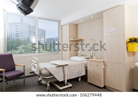 Hospital ward with bed and medical equipment - stock photo