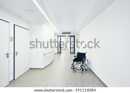 Hospital with wheelchair in the hallway - stock photo