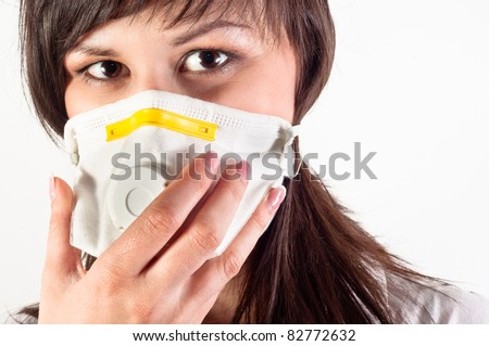 hospital worker wearing protective mask against white background - stock photo