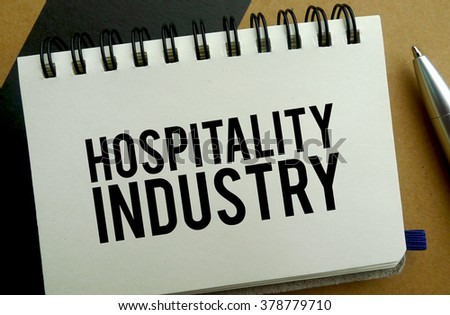 Hospitality industry memo written on a notebook with pen