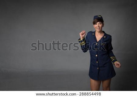 hostess in a wild dance, dark background - stock photo