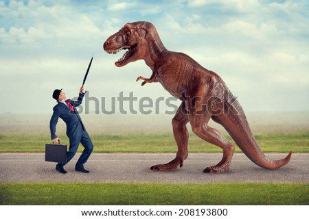 hostile business takeover concept businessman and tyrannosaurus - stock photo
