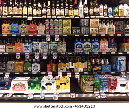 HOSTON,US-JUL 31,2016:Various bottles of craft, microbrews, IPAs, domestic and imported beer beers from around the world on shelf display in supermarket. Alcohol drinks background,different beer style