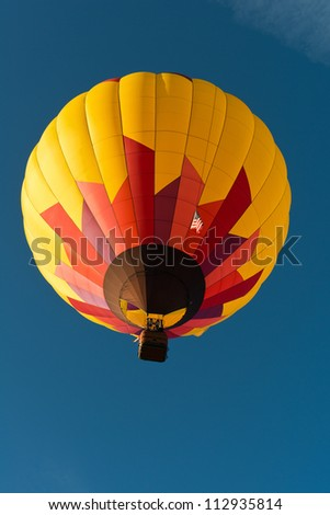Hot air balloon against a blue sky, Reno, Nevada - stock photo