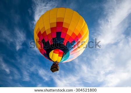 Hot air balloon against blue sky - stock photo