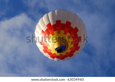 hot air balloon against blue sky under view - stock photo