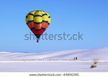 Hot air balloon and white sand dune - stock photo