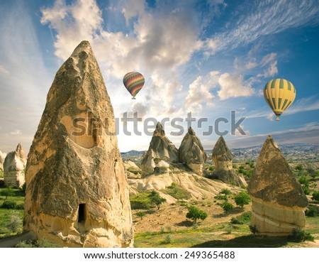 Hot air balloon flight over spectacular Cappadocia  - stock photo