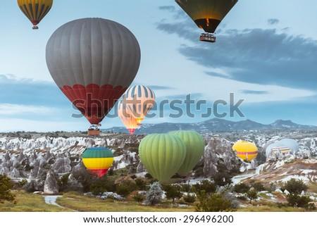 Hot air balloon flying over Cappadocia region, Turkey - stock photo