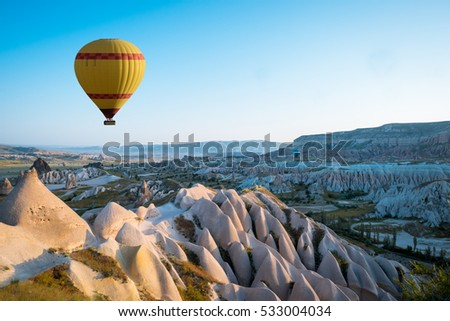 Hot air balloon flying over Cappadocia region, Turkey