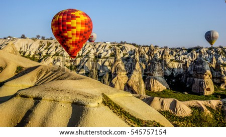 Hot Air Balloon flying over Cappadocia Turkey during sunrise in April