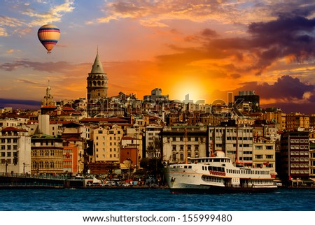 Hot air balloon flying over Galat tower, istanbul  - stock photo
