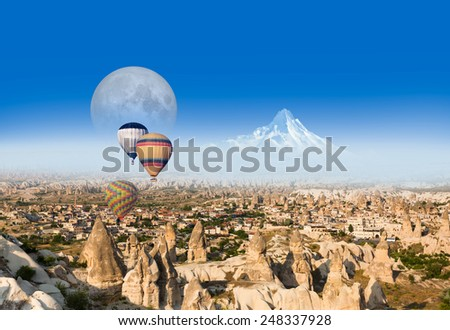 "Hot air balloon flying over spectacular Cappadocia .""Element s of this image furnished by NASA  - stock photo"
