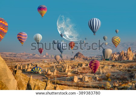 """Hot air balloon flying over spectacular Cappadocia """"Elements of this image furnished by NASA """" - stock photo"""