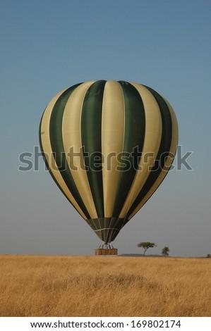 Hot air balloon flying over the Serengeti National Park - stock photo