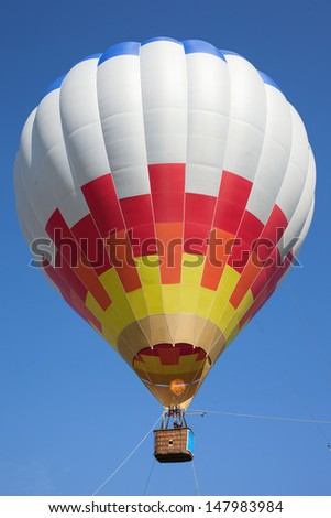 Hot air balloon in blue sky. - stock photo