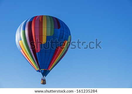 Hot Air Balloon In Flight Against A Bright Blue Sky At Letchworth State Park In New York State