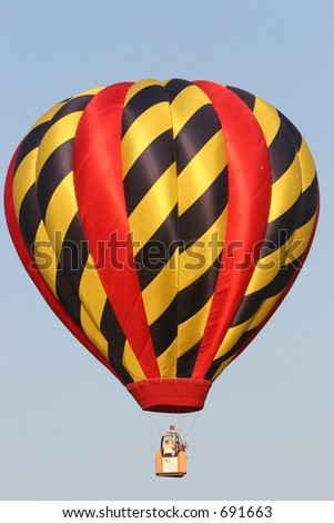 Hot air balloon in flight black, gold and red